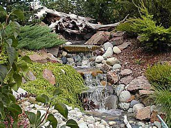 how to build a waterfall in your backyard the best backyard water feature will add interest and beauty