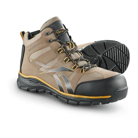 reebok boots s reebok hiker boots orange black