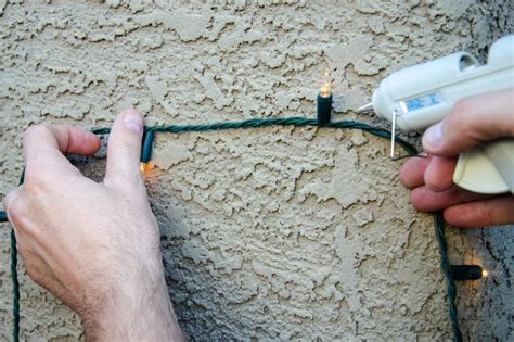 how to hang lights outside with outbusing nails how to hang lights on stucco hunker