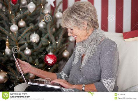 christmas elderly elderly sending greetings royalty free stock images image 32184439