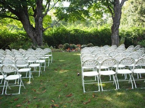 Wedding Ceremony Chair Setup by White Fan Back Chairs Setup For A Wedding Ceremony