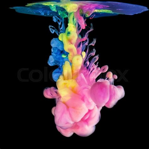 colored ink colored ink drops in water on black background stock