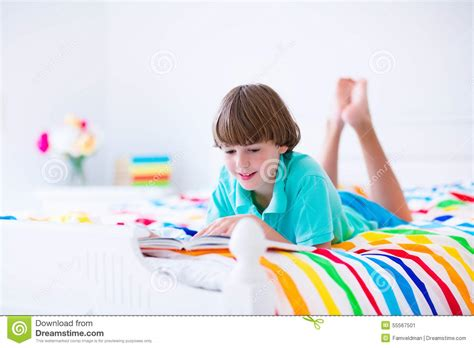 how to read a book in bed school boy reading a book in bed stock photo image 55567501