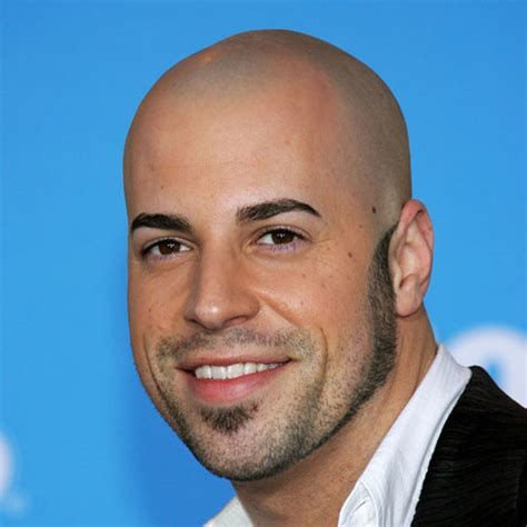Men s hairstyles a shaved head gives a youthful look