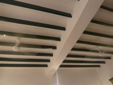 2 ceiling fans and high ceiling picture of anantha