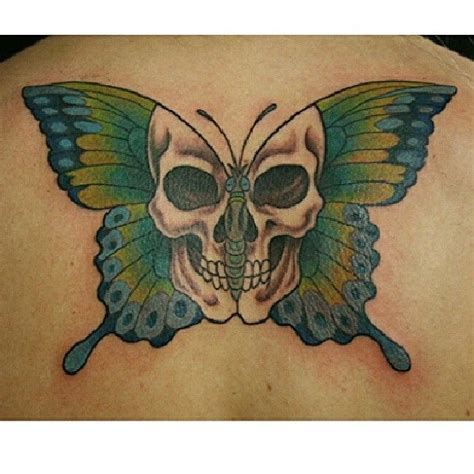 half butterfly tattoo designs butterfly with skull on back jpg 612 215 612