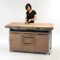 Table doubles as compact kitchen island combining kitchen and dining