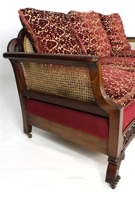 mahogany sofa antique mahogany upholstered bergere cane sofa settee antiques atlas
