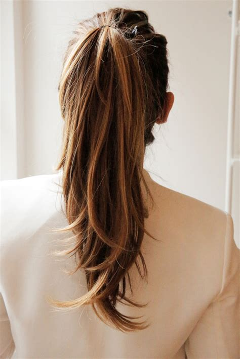pony tail with fringes back learn to do a black tie ponytail in a jiffy with gifs