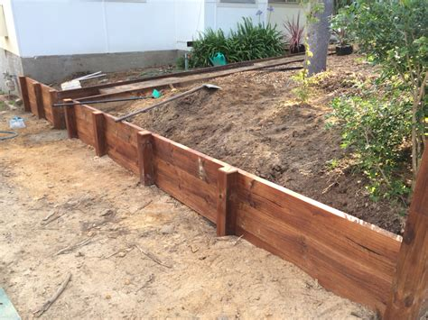 diy timber retaining wall in the making treated pine lengths with a jarrah stain diy ideas