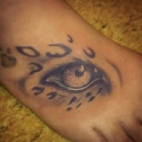 eye tattoo on ankle leopard eye foot black animal tattoo uncategorized