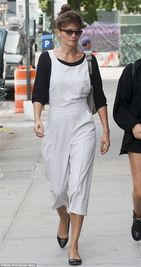 44 year old style helena christensen sports bizarre white dungaree outfit in