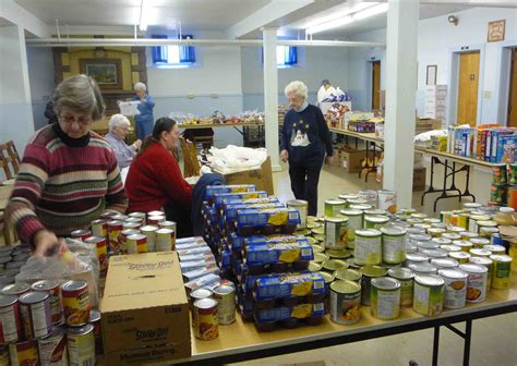 Volunteer At Food Pantry by Volunteer