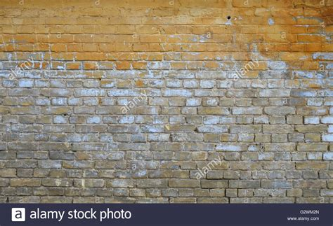 grunge vintage yellow and brown painted brick wall with blue and stock photo royalty free