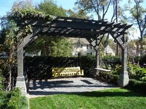 wood arbor and bench swings traditional landscape