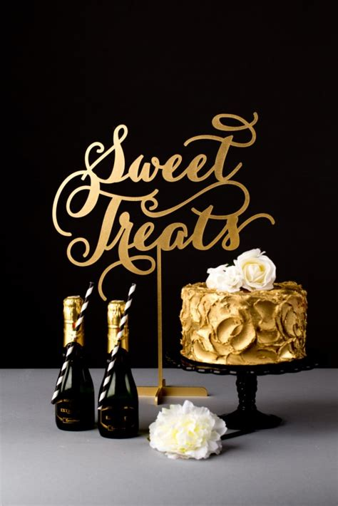 il_fullxfull.601081920_h4yq 645x967 black and gold sweet treat table signs on birthday cake candles sparklers