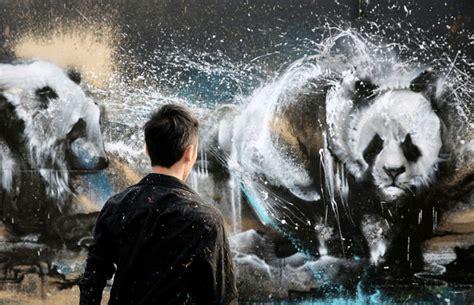 hua tunan creates  amazing panda mural  splatter ink