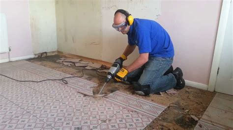 Titan SDS with a 80mm cranked tile chisel removing a