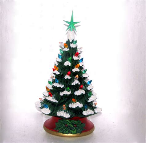 small ceramic christmas tree with faux snow 10 inches with