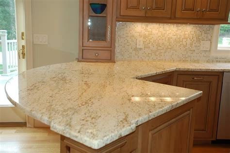 what color granite goes with cream cabinets cream white granite countertops what color granite