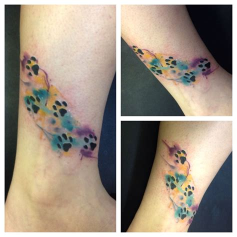 watercolor paw print tattoos by kirkwood