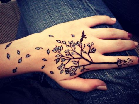 tattoo hand tree hand tree tattoo with roots and escaping leaves inked