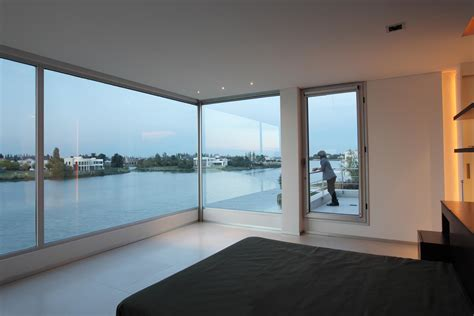 bedrooms and more mesmerizing open glass windows from house interior