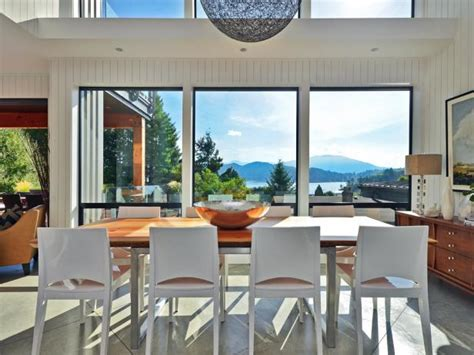 modern dining room  large glass windows overlooking