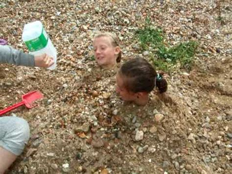 child trapped in me stuck in the sand