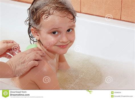 mom bathroom mom s hands are washed with soap back the young boy stock
