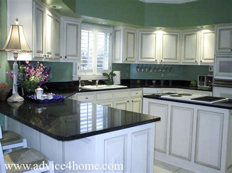 Black Kitchen Cabinets What Color On Wall White Washed Cabinets Design And Green Wall And Dramatic Black Countertops In Modern Kitchen