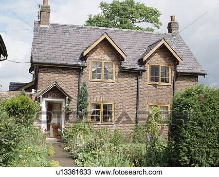 victorian brick country cottage  small garden  front