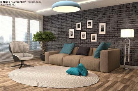 wohnzimmer mit steinwand sofa in braun wohnzimmer mit erdfarben einrichten