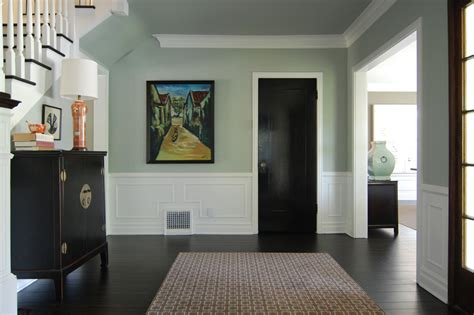 Black doors white trim hall traditional with white wood