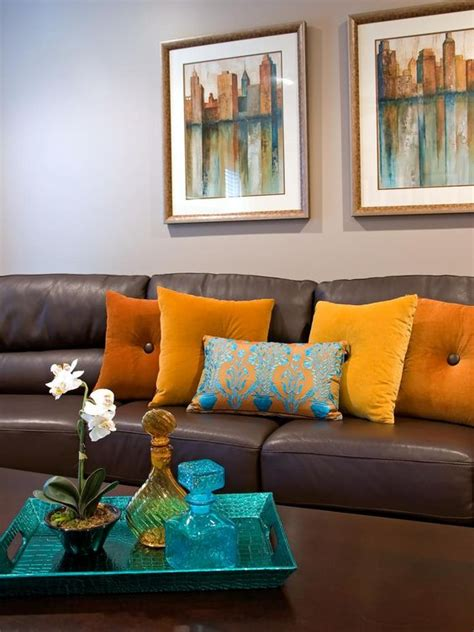 brown blue and orange living room a brown leather sofa matches a wooden coffee table in front of the neutral living room