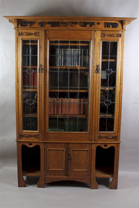 arts and crafts oak glazed bookcase with motto antiques