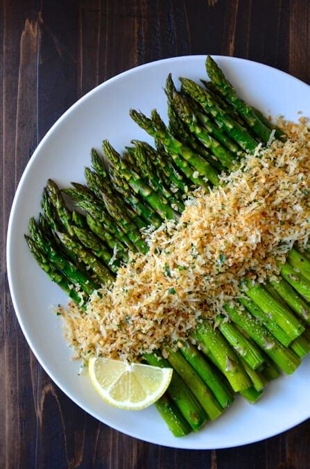 green asparagus goat cheese and flowers with an orange roasted asparagus with cheesy breadcrumbs just a taste