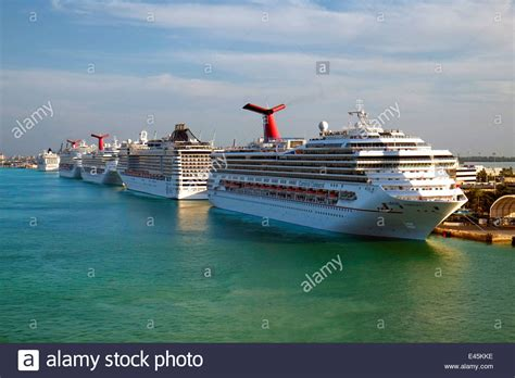 Car Rentals In Miami Port For Cruises by Carnival Conquest Msc Divina Port Of Miami Cruise Ship Docks Florida Stock Photo Royalty Free