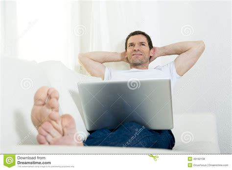 happy attractive man freelance working with computer