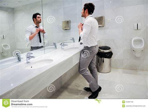 men public bathroom man getting dressed in a public restroom stock photography