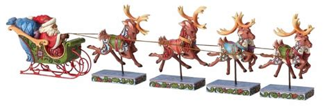 reindeer statue reindeer rides 5 cents jim shore dash away all santa and reindeer sleigh figurine set 4055048 ebay
