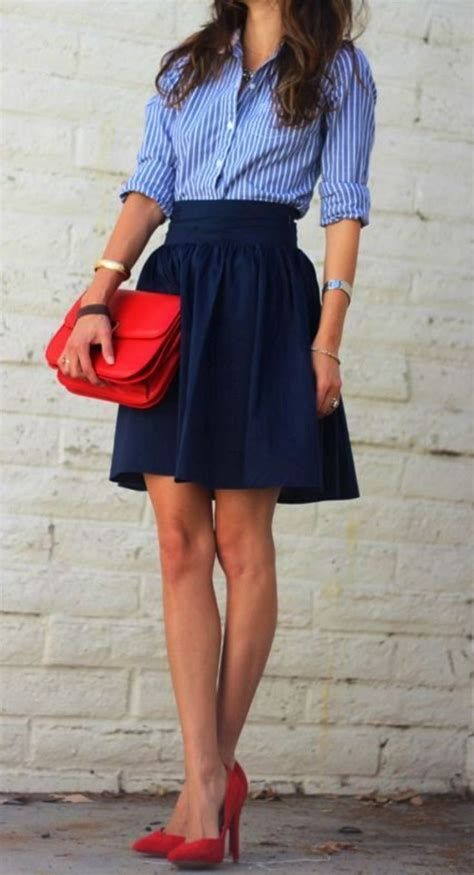 a striped button shirt tucked into navy skirt is
