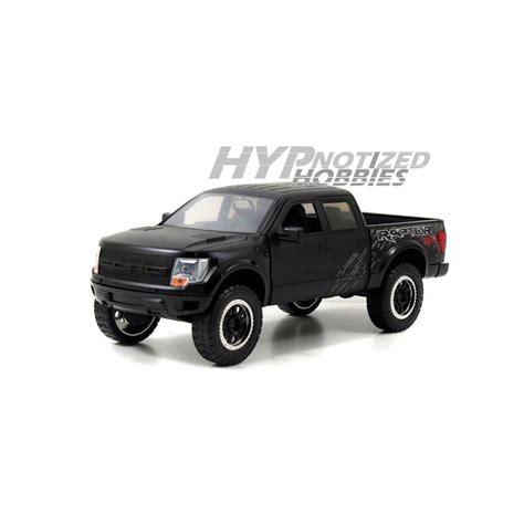 1 24 2011 Ford F 150 Svt Raptor Truck Y1313 1 24 2011 ford f 150 svt raptor die cast matte black 96867 ebay