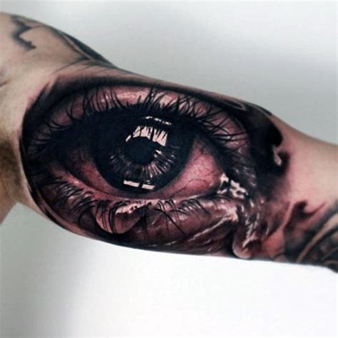 tattoo of someone s lips awesome inner arm tearing eye mens tattoos tattoos