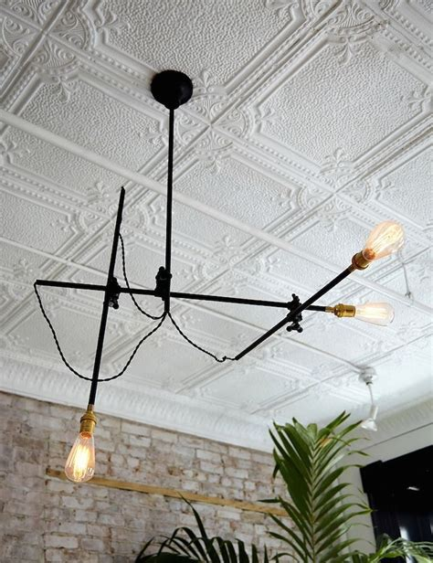 Ceiling Tile Light Fixture Best 20 Tin Ceilings Ideas On Pinterest Tin Ceiling Kitchen Kitchen Ceilings And Ceiling Ideas