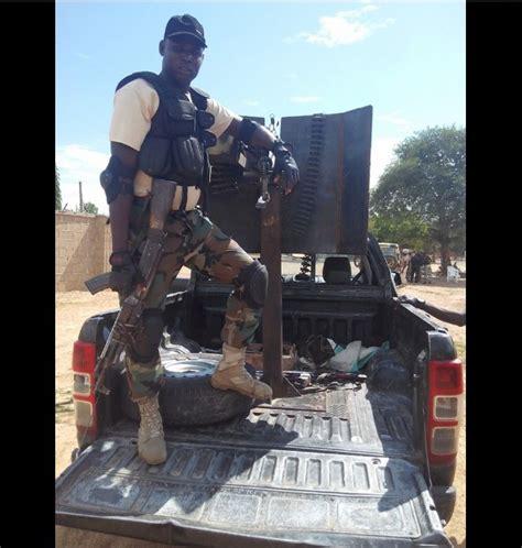 soldier poses  dead body   boko haram member