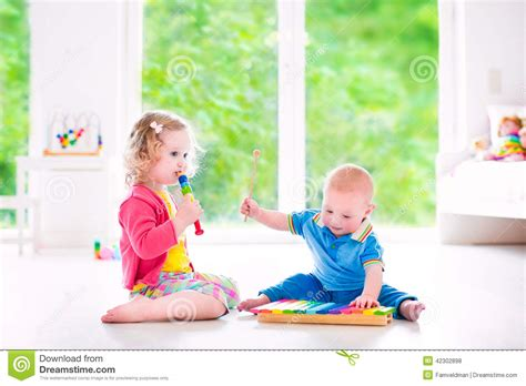 Daycare Floor Plans kids playing music with xylophone stock photo image