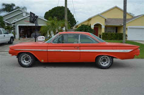 orange impala seller of classic cars 1961 chevrolet impala hugger