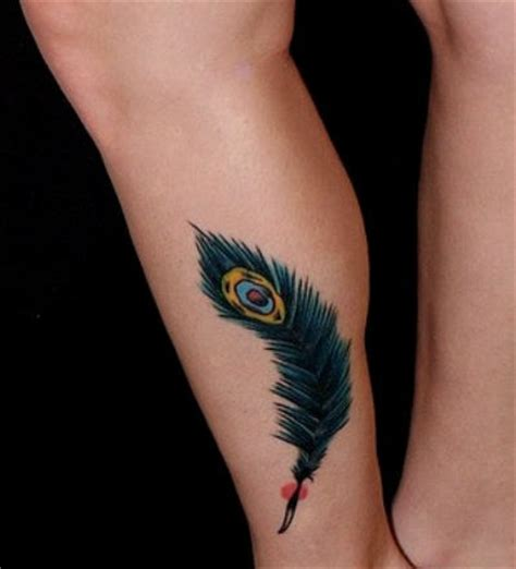 cute leg tattoo designs feather on lower leg