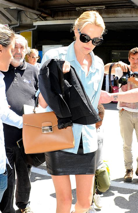 Charlize Theron With And Balenciaga Purses by The Many Bags Of Charlize Theron Purseblog
